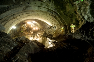 Workers observe a major project milestone on the Caldecott Fourth Bore project in Northern California – tunnel breakthrough occurred in late November 2011 when the top portion of the west and east sides of the tunnel met.