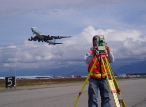 Surveying Ted Stevens Anchorage International Airport. Korean Air cargo jet flying over.