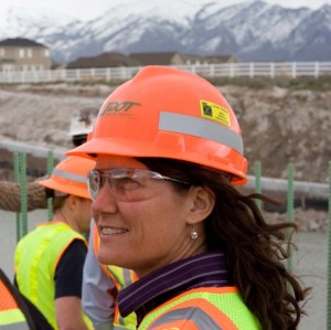 Mountain View Corridor Project Director Teri Newell looks on as crews work on the new 15-mile roadway. Newell has overseen this $1.035 billion project from the beginning.