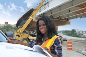 Hermanie Pierre, a Civil Engineer I with the Arkansas State Highway & Transportation Department, inspects Phase III construction for improvements to the Interstate 430-630 interchange in Little Rock.