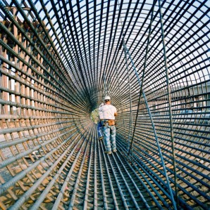 A construction worker inspects rebar to be used in a bridge column on a freeway interchange in Orange County, California.