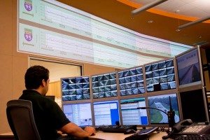 Edwin Melendez, FDOT District Four Regional Transportation Management Center operator, monitors incidents on the mini video wall at a workstation in the control room.