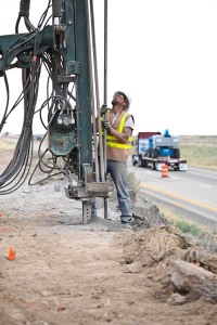 This is a long shot of an explosives driller prepping for rock blasting on Interstate 84 near Boise.