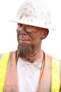 Close-up of an explosives expert just after heavy drilling in preparation for rock blasting.
