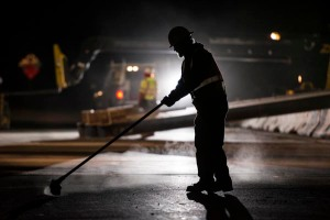 Unknown worker sweeps up State Route 4 after a quick four lane closure during the night for construction.