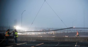 Workers install rebar on a foggy morning in Pittsburg CA at the Loveridge overpass.