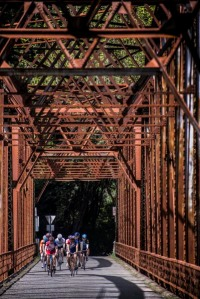 Cyclists ride across an old bridge near Graton, California.