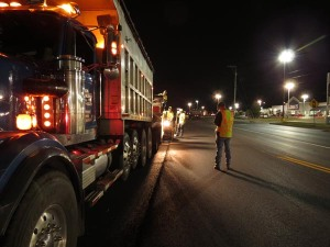 Progress looks different at night, as the asphalt train of trucks and pavers line up beside contractors and Kentucky Department of Highways inspectors to give the daytime commuters a safer and smoother ride.