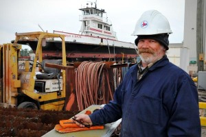 Tommy Blayden, a welder with the NCDOT Ferry Division, preps a section of a ferry's hull plate. The plate will later be welded into place, thus, maintaining the sea worthiness of vessel and extending its future safe use.