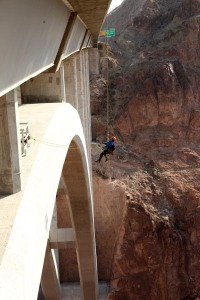 Brave inspector Trask Bradbury hangs out over the Mike O'Callaghan-Pat Tillman Memorial Bridge (Hoover Dam Bypass) during a routine biennial bridge inspection. The concrete-steel composite arch bridge looms 840 feet above the Colorado River and is the 2nd largest bridge in the United States at 1,900 feet in length.