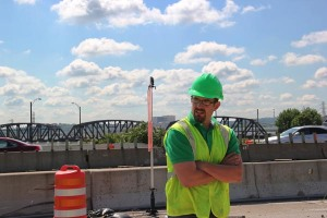 ODOT Transportation Engineer Josh Bowman is shown on the site of the Interstate 75 Modernization in Dayton, Ohio. Josh has played an integral role in all phases of the project to improve safety, decrease congestion, and provide much-needed updates to the more than 50-year-old highway serving the downtown area.