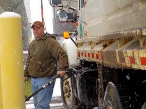 Chad Dial of Holmes County in Ohio is refueling an Ohio Department of Transportation snowplow during a winter event in February 2013. He is one of the many at ODOT who work around the clock in cold weather to keep Ohio highways safe during the snow and ice season.
