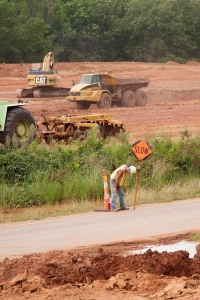 A tired worker directs traffic at an Oklahoma Department of Transportation work zone on SH-9A near Maud.