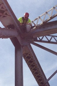 Oklahoma Department of Transportation bridge inspector Wes Kellogg scales the US-169 truss bridge over Bird Creek in Tulsa to perform a detailed inspection.