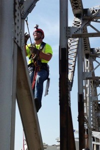 Oklahoma Department of Transportation bridge inspector Wes Kellogg climbs a bridge beam to perform a up-close inspection of the US-169 truss bridge over Bird Creek in Tulsa.