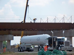 Durant Oklahoma is getting a new bypass on US 70. Workers weld pieces into the bridge supports. The road below remained open throughout construction.