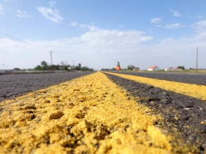 Fresh paint on an asphalt road has been put down on Western Ave. between 149th and 164th Street in Norman, OK.