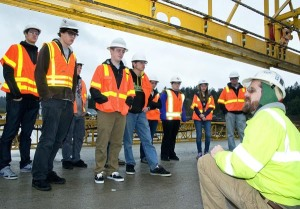 OBEC Consulting Engineers' Brad Larsen led students from Churchill High School's science, technology, engineering and mathematics program on a tour of the Oregon Department of Transportation's Interstate 5 Willamette River Bridge project. Larsen explained the bridge's design to the students, who used their learning on their own bridge design project.