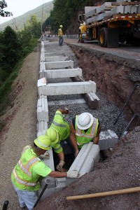 A PennDOT crew in Engineering District 3-0 expands its in-house capabilities with the installation of a retaining wall along Traffic Route 414 in the Pine Creek Valley of Lycoming County, PA.
