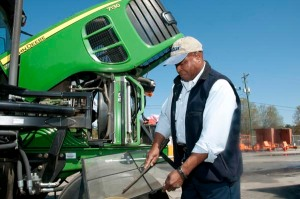 Herbert Brown checks the air filter on a tractor during a vehicle inspection before going out to trim vegetation along the highways in Colleton County, South Carolina. Brown is the vegetation foreman for the South Carolina Department of Transportation's Colleton Maintenance Office.
