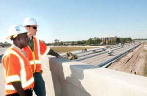 Rickie Green of SCDOT's Charleston Contruction B Office, left, and HDR Project Manager David Wertz supervise the construction work on Interstate 26 in North Charleston, SC.