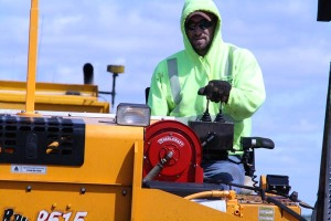 Matt Vobr, Highway Maintenance Worker from Winner, operates the asphaltite machine on Highway 183 in Tripp County as part of the South Dakota Department of Transportation's asphalt patching work.