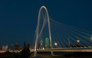 A beautiful, jaw-dropping arch of concrete and steel, the Margaret Hunt Hill Bridge unites Dallas both literally and figuratively. The bridge, an extension of the Woodall Rodgers Freeway designed by noted Spanish architect Santiago Calatrava, connects Uptown and West Dallas where they meet at the Trinity River.
