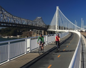 Bay Area residents John Davidson and Thalia Pascalides enjoy cycling on the new San Francisco-Oakland Bay Bridge Pedestrian and Bicycle Pathway on October 14, 2013. Since opening on September 2, 2013 many cyclists have enjoyed breathtaking vistas from the new bridge and observed demolition of the old Bay Bridge.