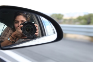 Photographer Sholeh Moll of the Nevada Department of Transportation photographs semi-trucks and other traffic related images from the passenger seat of a state car while on a trip through rural Nevada.