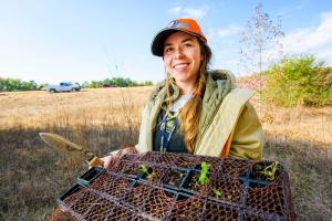 Kayti Ewing holds a flat of milkweed she is about to plant in right-of-way off I-430 in Little Rock, Arkansas. The plants are meant to help the habitat of Monarch butterflies as they migrate through Arkansas.