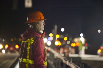 An Idaho Transportation Department worker oversees placement of girders for the Meridian Interchange in Meridian, Idaho. The overnight job began at 10 p.m.