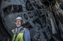 Innovator Matthew Fowler, Project Engineer for San Francisco Central Subway, stands before one of the large TBMs (Tunnel Boring Machines) used to create the new San Francisco Central Subway Project. Central Subway Project 1731 Powell Street San Francisco July 11th 2014. 