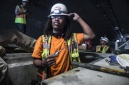 Apprentice electrician Kendall Evans adjusts his helmet before he finishes up electrical work in Doyle Drive Tunnel 7/7/15. 