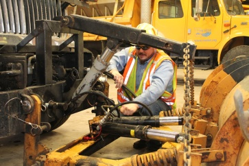 Joplin Maintenance Worker Jay Lovatt checks the hydraulics on a snow plow ahead of an expected snow storm March 3, 2015. Nearly 300 plows are deployed to make the Southwest District's highways safe for motorists during winter weather.