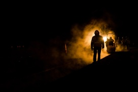 The Fortify construction project is part of a 10-year plan to strengthen North Carolina's roadways and alleviate traffic congestion in the Triangle. The southern portion of I-40/I-440 is 30 years old and needs repair. This photo, taken on a bitterly cold February night, depicts the dedicated workers on that project.