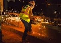 Sparks fly as construction crews work quickly to remove an old bridge over I-235 in Oklahoma City during a complete closure of the entire interstate overnight.