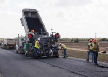 Construction crews help pave the way for the brand new US-70 Durant Bypass, which will improve traffic movement by re-routing commercial traffic around the city's southern edge.