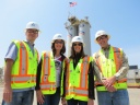 Members of the California Legislature tour a Teichert Materials asphalt plant and quarry April 23, 2015 in Sacramento California. Pictured, from left: Assemblyman Eric Linder, R-Coronoa, Assemblymember Catharine Baker, R-Dublin, Assembly Minority Leader Kristin Olsen, R-Modesto, and Teichert Regional Operations Manager Mike Cunningham. Asphalt storage tanks are in the background.