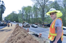 SCDOT Lexington Construction B employee Allen Frierson manages and monitors the work of contractors as they replace a bridge and realign the roadway of a portion of Hope Ferry Road off U.S. 378 in Lexington County.