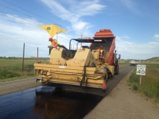 SR 87 Chip seal: Employees work a chip sealer to improve SR-87 in Duchesne County, Utah. The route is an important connector for small rural communities wanting to access Roosevelt and Duchesne.