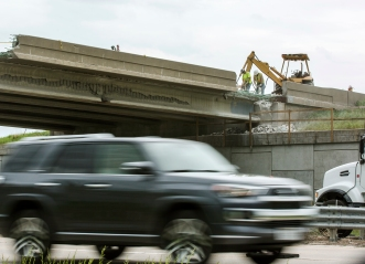 Repair efforts are seen in progress on the Highway 15 bridge over Highway 30 north of Schuyler on Tuesday, May 29, 2018. Photo/Jake Daniels